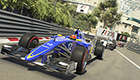 Pressure builds on the Sauber C34 as it leads the pack in Monaco.