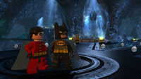 Batman and Robin admire the Batcave's decor.