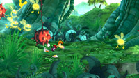 Rayman narrowly avoids a swinging spiky fruit as he pursues an enchanted Lum full of magical energy.