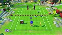 Even when playing tennis, Sonic can't resist collecting power rings.